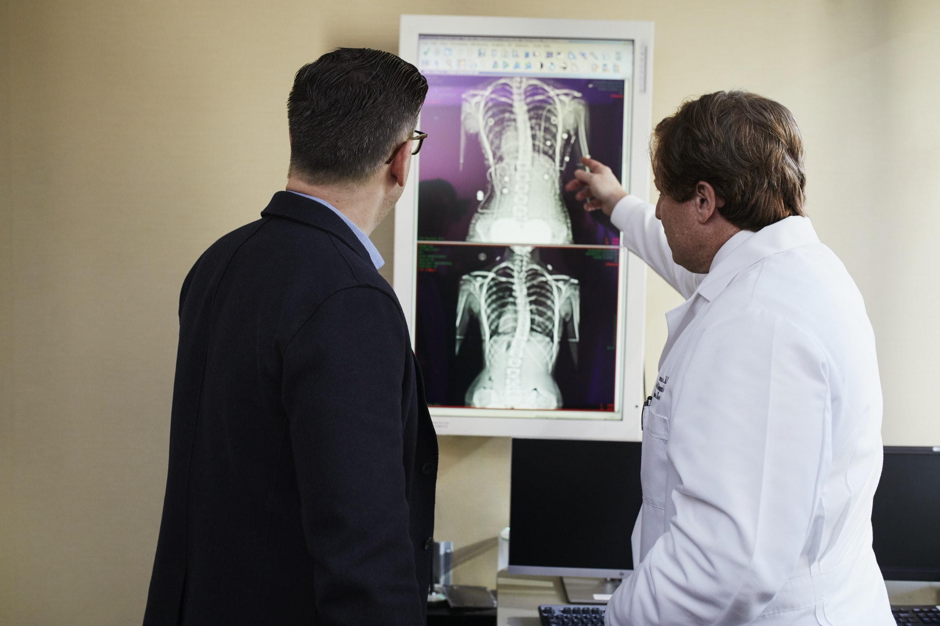 Doctor Examines Herniated Disc X-ray